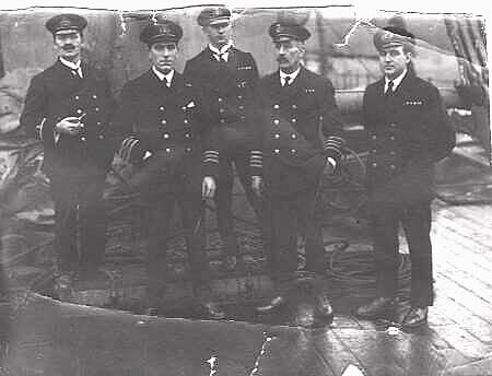 [Left to right]: Sub-Lieutenant A. A. Porter CTNCC [Officer-in-charge of the Cape Town Naval Cadet Corps contingent]; Lieutenant T. Ure RNR [Chief Officer]; Captain F. B. Renouf [Master]; Mr. Carter [Chief Engineer] and Lieutenant Mitchell RNAS [Second Officer]